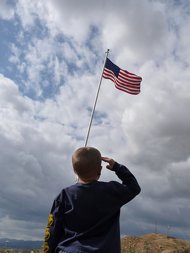 Child Saluting American Flag, by respres on Flickr