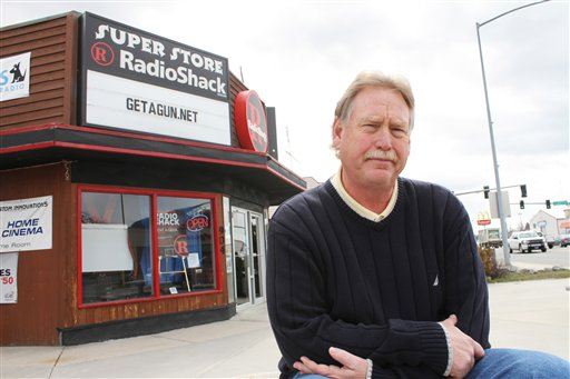 Steve Strand, who has owned the Radio Shack in Hamilton, Mont. for seven years, poses in front of his store Tuesday, March 29, 2011. Strand said he is going to fight any effort to stop his sales promotion that allows customers with a clean record to get a free gun when they sign up for new Dish Network service. (AP Photo/Ravalli Republic, David Erickson)